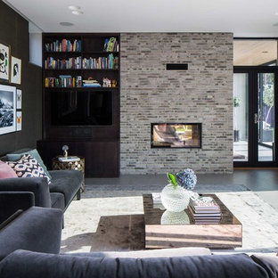 Inspiration for a medium sized contemporary formal open plan living room in Malmo with black walls, ceramic flooring, a two-sided fireplace, a brick fireplace surround and no tv.