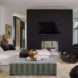 Idee per un soggiorno minimal con camino bifacciale