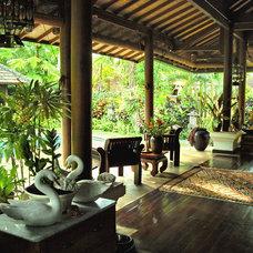 Tropical Living Room by SCR Design & Associates