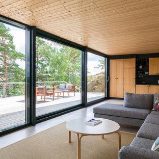Bild på ett skandinaviskt allrum med öppen planlösning, med ett finrum, betonggolv och grått golv