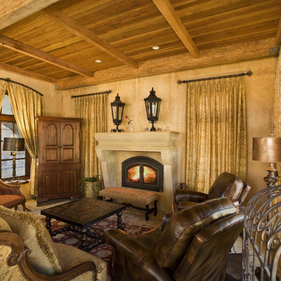 Inspiration for a mediterranean enclosed living room remodel in San Francisco with beige walls, a standard fireplace and no tv