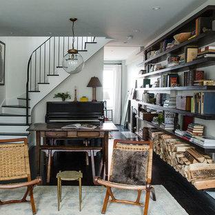 ニューヨークの小さいトランジショナルスタイルのおしゃれなLDK (白い壁、濃色無垢フローリング、標準型暖炉、ミュージックルーム、石材の暖炉まわり、テレビなし) の写真