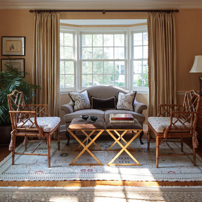Example of a classic living room design in New York with beige walls