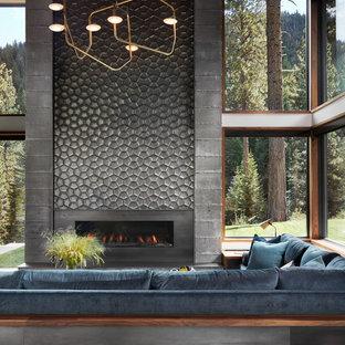 サンフランシスコの巨大なモダンスタイルのおしゃれなLDK (白い壁、磁器タイルの床、横長型暖炉、タイルの暖炉まわり、テレビなし、グレーの床、フォーマル) の写真