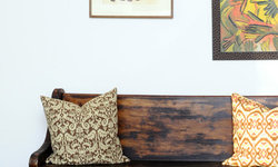 Vintage Deacon's Bench (Church Pew) with Ikat Pillows and Oil Paintings