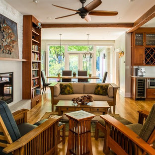 Example of an arts and crafts formal and open concept medium tone wood floor living room design in Atlanta