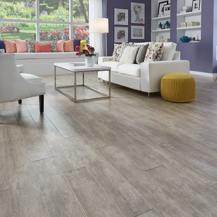 Large trendy formal and open concept medium tone wood floor and gray floor living room photo in Other with beige walls