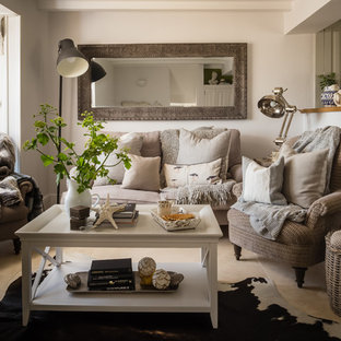 Small nautical enclosed living room in Dorset with beige floors.