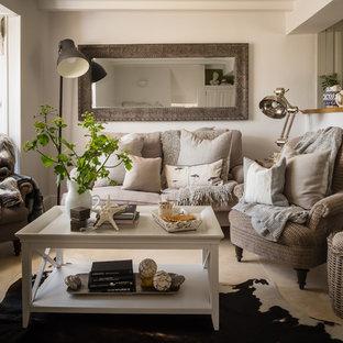 Example of a small coastal enclosed beige floor living room design in Dorset