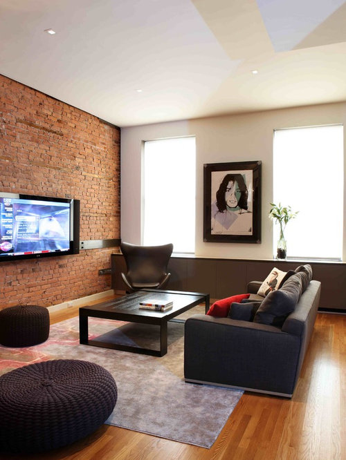 Trendy Medium Tone Wood Floor Living Room Photo In New York With A Wall Mounted