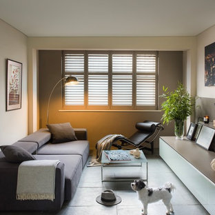 Inspiration for a contemporary living room in London with beige walls and grey floors.