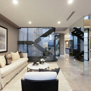 This is an example of a contemporary formal open concept living room in Sydney with grey walls, no fireplace, no tv and multi-coloured floor.