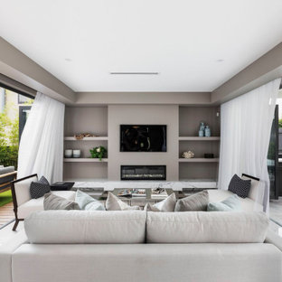 Inspiration for a contemporary open concept living room in Sydney with grey walls, a ribbon fireplace, a wall-mounted tv and white floor.