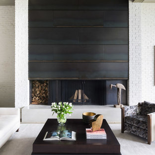 他の地域の中サイズのインダストリアルスタイルのおしゃれなLDK (フォーマル、白い壁、コンクリートの床、横長型暖炉、レンガの暖炉まわり、ベージュの床) の写真