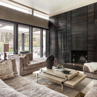 Design ideas for a contemporary living room in New York with brown walls, dark hardwood flooring, a standard fireplace and brown floors.