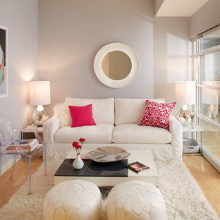 Example Of A Transitional Formal And Enclosed Light Wood Floor Living Room Design In New York