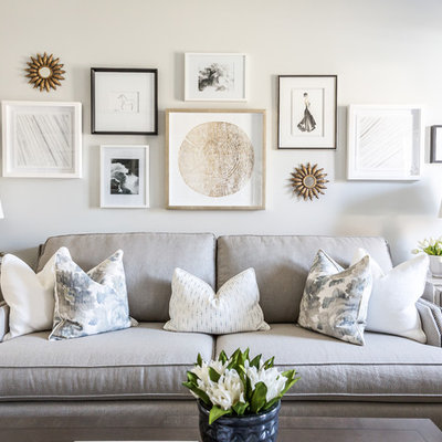 Example of a classic living room design in Montreal with white walls