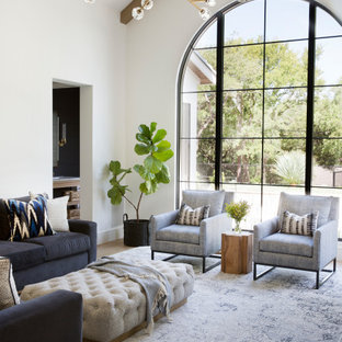 Photo of a large mediterranean formal living room in Austin with white walls and beige floor.