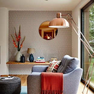 Inspiration for a mid-sized contemporary light wood floor and brown floor living room remodel in New York with multicolored walls