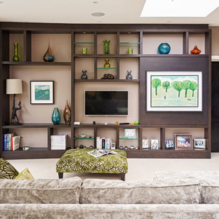 Photo of an expansive world-inspired enclosed living room in London with brown walls and a wall mounted tv.