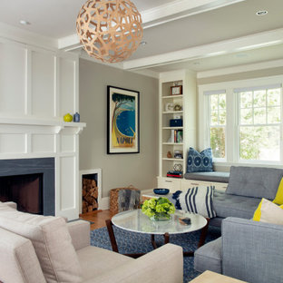 Example of a mid-sized transitional formal and open concept light wood floor living room design in Boston with beige walls, a standard fireplace, a stone fireplace and a concealed tv