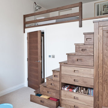 Walnut stairs with storage solutions
