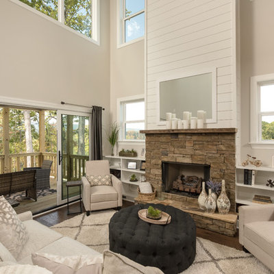 Cottage dark wood floor living room library photo in Other with beige walls, a ribbon fireplace, a stone fireplace and no tv