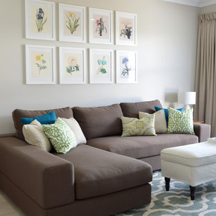 Small transitional enclosed living room in Townsville with beige walls and ceramic floors.