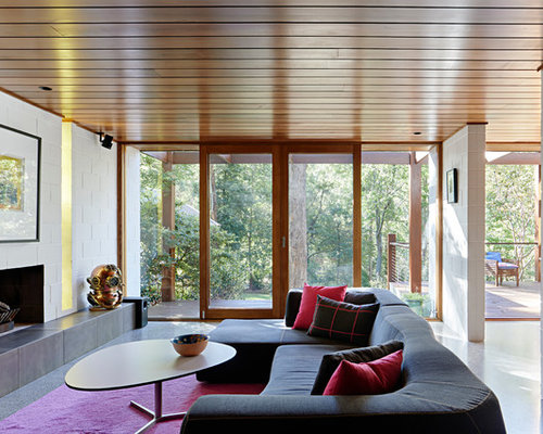 Mid Sized Midcentury Formal Open Concept Living Room In Melbourne With  White Walls, Concrete
