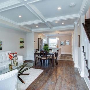 Foto di un soggiorno design di medie dimensioni e stile loft con sala formale, pareti beige, parquet scuro, camino classico, nessuna TV e pavimento marrone