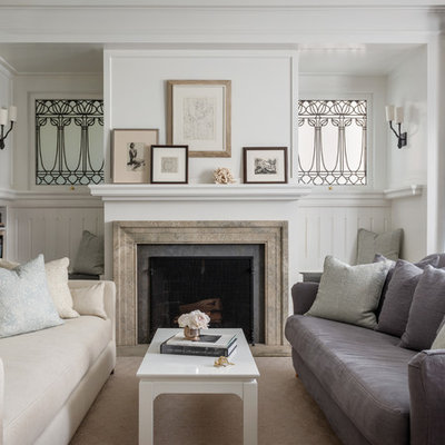 Example of a transitional enclosed living room design in San Francisco with white walls and a standard fireplace