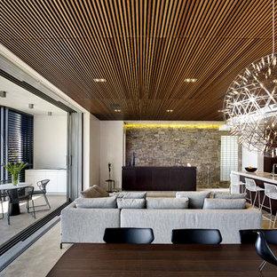 Idéer för ett mellanstort modernt allrum med öppen planlösning, med vita väggar, betonggolv och en dold TV
