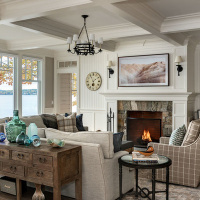 Inspiration for a coastal formal light wood floor living room remodel in Boston with white walls, a standard fireplace, a stone fireplace and no tv