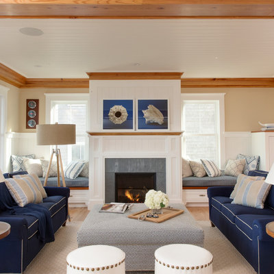 Example of a large beach style formal and open concept medium tone wood floor and beige floor living room design in Boston with beige walls, a standard fireplace, a stone fireplace and no tv