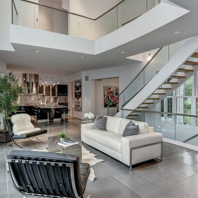 Living room - large contemporary open concept and formal concrete floor and gray floor living room idea in DC Metro with white walls, a standard fireplace, a tile fireplace and no tv