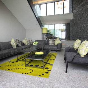 Large contemporary formal open plan living room in Wiltshire with grey walls.