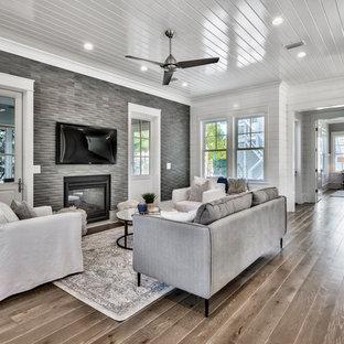 Immagine di un soggiorno stile marino di medie dimensioni e aperto con pareti bianche, parquet scuro, camino bifacciale, pavimento marrone, sala formale e nessuna TV