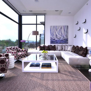 Example of a large trendy formal and open concept dark wood floor living room design in Austin with white walls and no tv