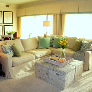 Large beach style open plan living room in Miami with white walls, carpet and a wall mounted tv.