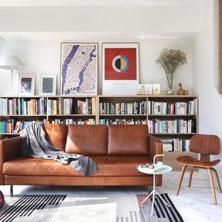 Ejemplo de biblioteca en casa abierta, moderna, con paredes blancas y suelo gris