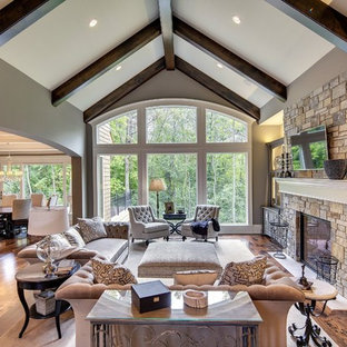 Inspiration for a transitional living room remodel in Minneapolis with beige walls, a standard fireplace and a stone fireplace