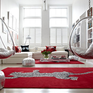 Example of a trendy light wood floor living room library design in London with white walls and no fireplace