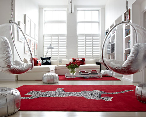 example of a trendy light wood floor living room library design in london with white walls