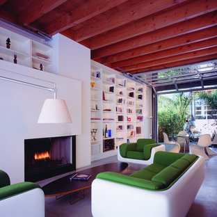 Inspiration for a modern concrete floor living room library remodel in Los Angeles with a standard fireplace