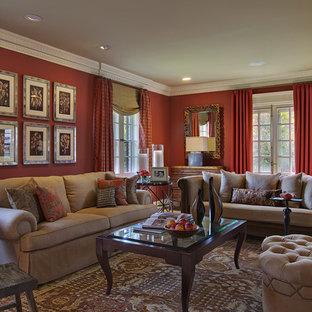 Diseño de salón para visitas bohemio con paredes rojas