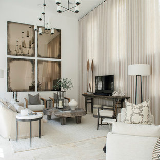 Inspiration for a large beach style enclosed beige floor living room remodel with white walls, no tv and a corner fireplace