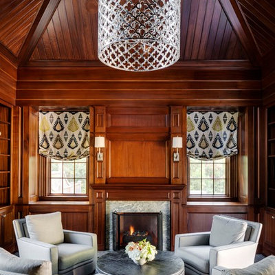 Living room - traditional formal and enclosed carpeted living room idea in Boston with brown walls, a standard fireplace and a stone fireplace