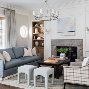 Inspiration for a large transitional formal open concept living room in Boston with white walls, medium hardwood floors, a standard fireplace, a tile fireplace surround, no tv, brown floor and decorative wall panelling.