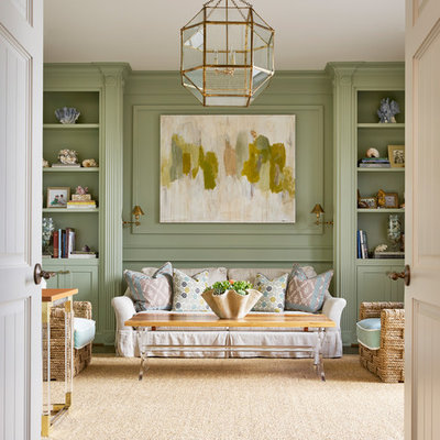 Example of a transitional formal and enclosed medium tone wood floor living room design in Dallas with green walls and no tv