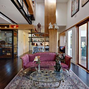 Inspiration for a modern open concept dark wood floor living room remodel in Austin